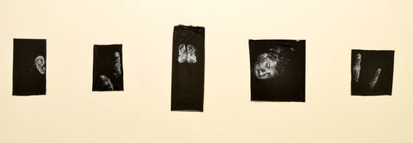 Estudios de un cuerpo humano (Studies of a Human Body), 2015, oil pastel on trash bags, 11 x 55 in.