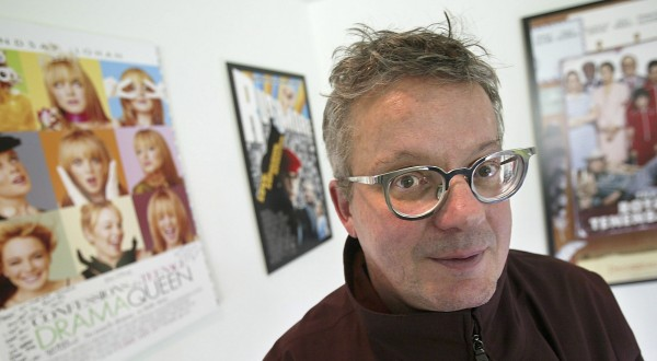 "Mark Mothersbaugh poses for a photo Tuesday, Jan. 18, 2005, at his studio in Los Angeles. Chances are you've heard Mothersbaugh's work, but how depends on your age and taste. Rock fans saw him bounce around in a yellow jumpsuit and red dome as a member of Devo. Kids giggle to his music in ""Rugrats."" Teens hear it while immersed in PlayStation games. And moviegoers heard it in the background during ""The Life Aquatic,"" ""Thirteen"" and ""Rushmore."" (AP Photo/Ric Francis)"