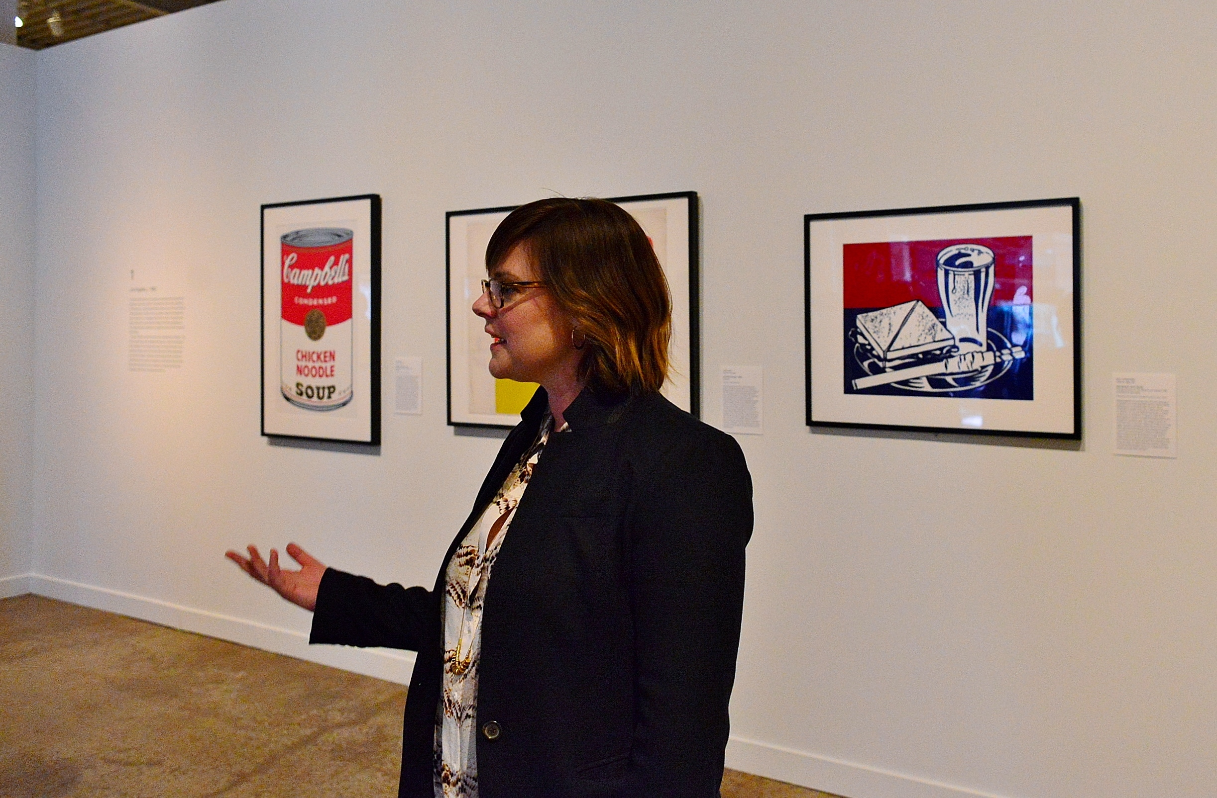 Anna Stothart touring the Cowden Gallery at San Antonio Museum of Art, flanked by Andy Warhol and Roy Lichtenstein