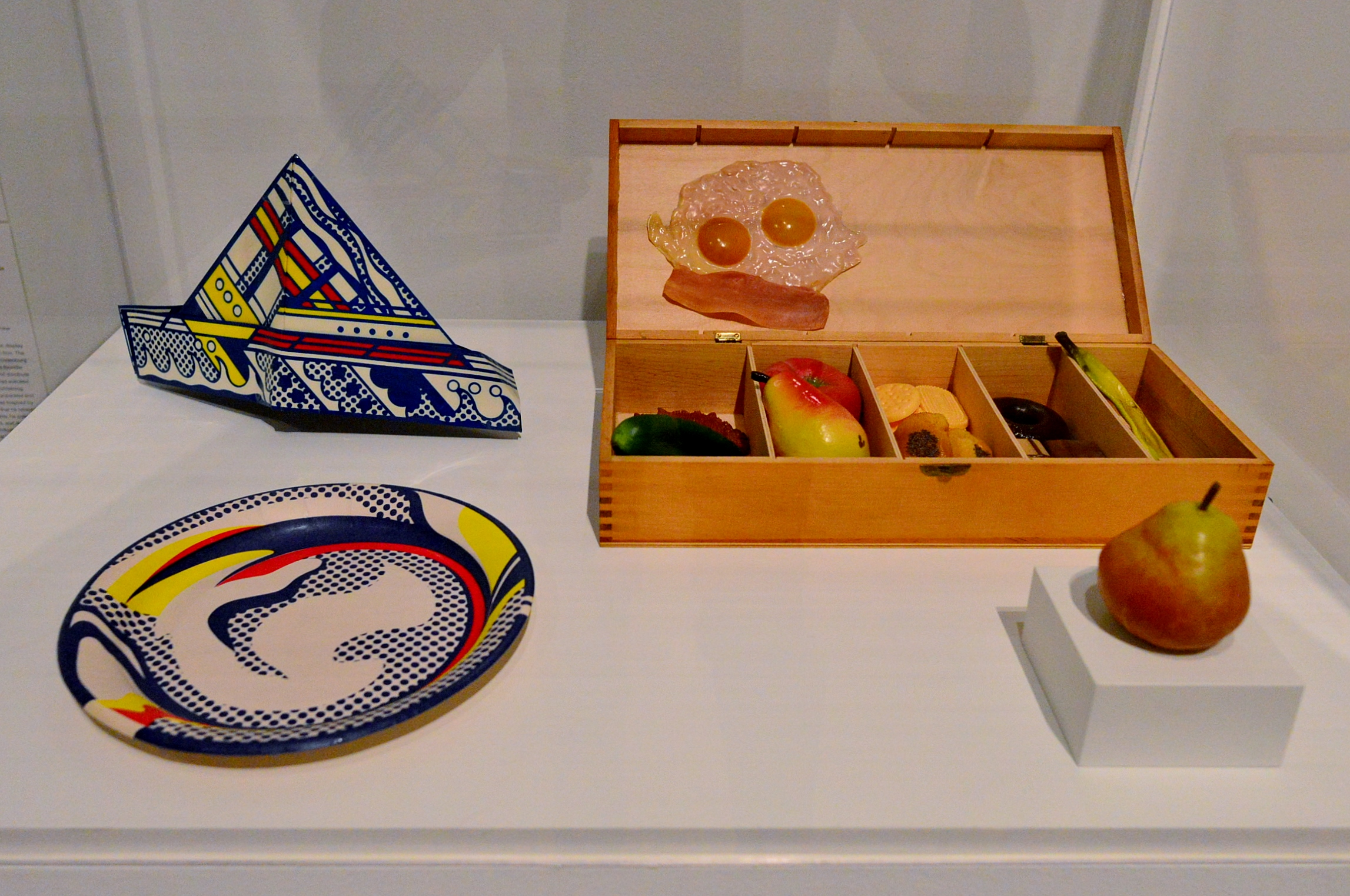By Roy Lichtenstein (clockwise) Paper Plate and Folded Hat shown with False Food Selection and Pear by Claes Oldenburg.