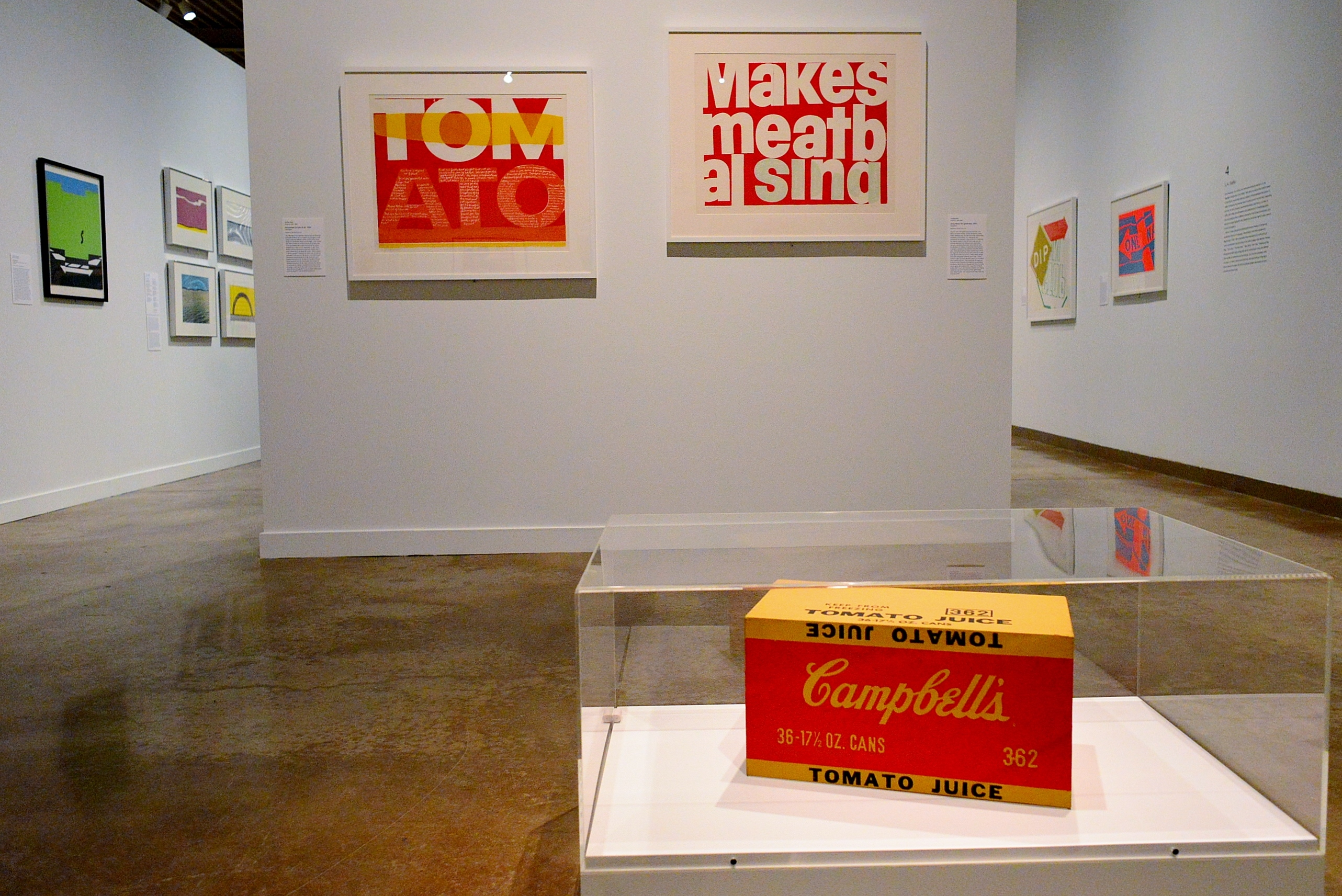 the juiciest tomato of all and song about the greatness (l-r) by Corita Kent. Andy Warhol's Campbell's Tomato Juice Box (foreground)