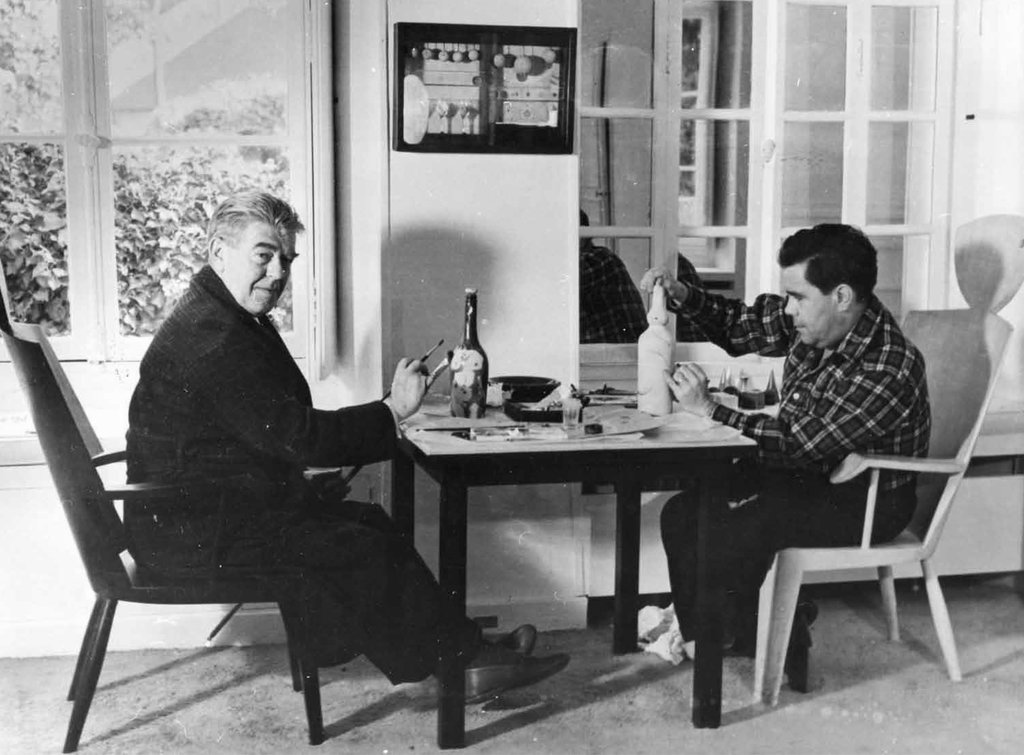 René Magritte and William Copley painting in Copley's house, Longpont-sur-Orge, 1959