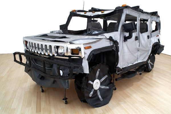 Hummer, 2006, vinyl, thread, car parts, 84 x 180 x 96 in.