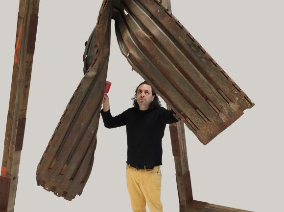 Guillermo Galindo Playing The Angel Exterminador (Exterminating Angel) Section of border wall, Border Patrol drag chain, wood blocking used in construction of border wall