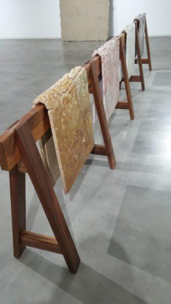 Draped Marble (Fior di Pesco Carnico, Fior di Pesco Apuano, Crema Dorlion, Onyx), marble mounted on steel on wooden sawhorse, 2015