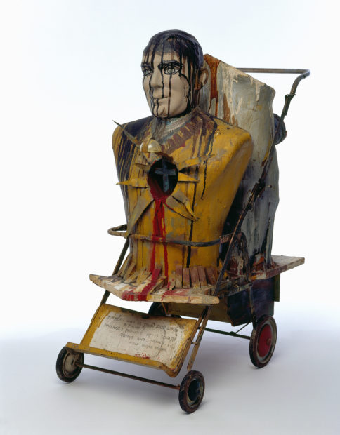 Edward Kienholz, John Doe, 1959. Oil, metallic paint, resin, plaster, and graphite on mannequin parts with wood, metal, plastic, paper, rubber, and stroller, 39 1/2 × 19 × 31 1/4 in.