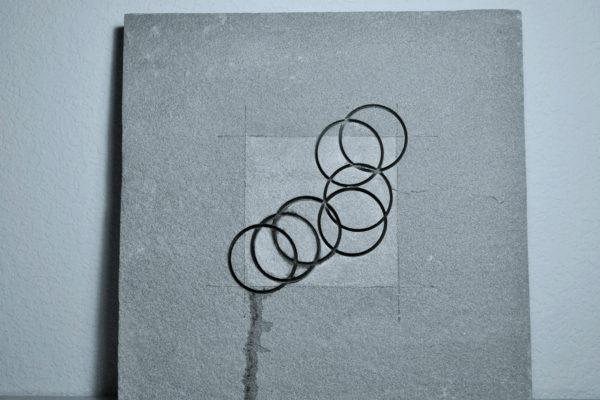 "Susan Sitzes, No Looking Back, 2014, Pennsylvania Blue stone, watercolor, colored pencil, 12""x12""x1.5"""