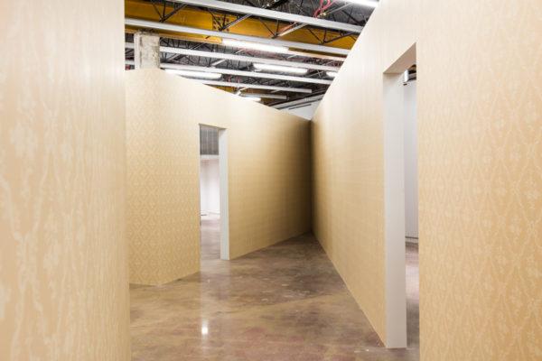 Monika Sosnowska, Antechamber, 2016. Constructed walls and hand block- printed wallpaper. Dimensions variable.