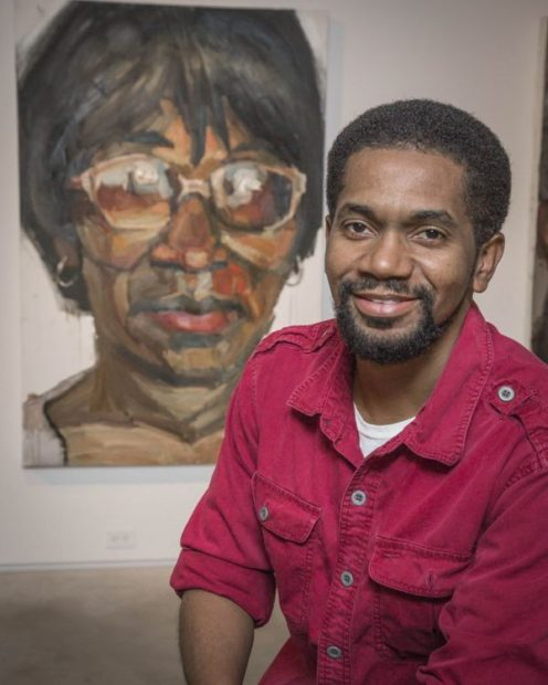 Sedrick Huckaby poses with a large painting of his mother, Ruthie Huckaby of Fort Worth, at the Valley House Gallery in Dallas, in 2013. (Ron Heflin/Special Contributor via Dallasnews.com)
