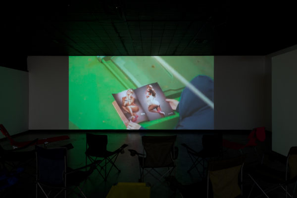 Zoom Test, Liz Rodda, installation view of video with camp chairs, 2016.