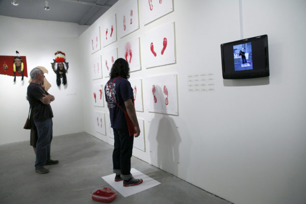Indian Standing in the Exact Spot Looking at Contemporary Native American Art II, 2012, performance