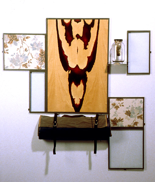 Heterotaxia #2, 1994, oil on printed fabric and birch plywood, plate glass, steel frame, jar with molding bread, shooting mat, 58 x 57 x 4 in.