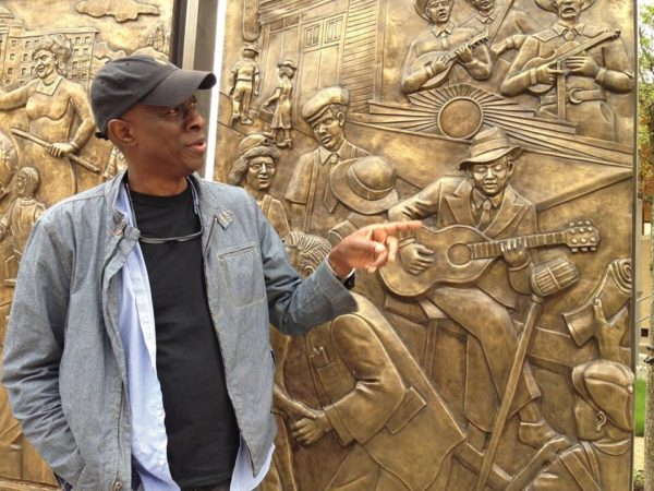 Encore Park Sculpture Wall - blues musician Keb Mo gesturing to Robert Johnson in panel (credit Jeffrey Liles)