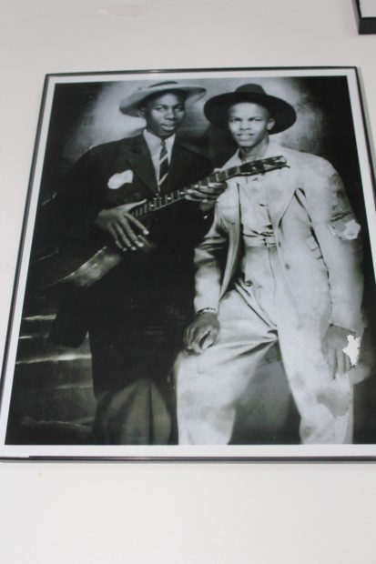 NotRobertJohnson (in the exhibit). This photograph appeared in Vanity Fair in 2008, where it was identified as Robert Johnson and fellow musician Johnny Shines. Lively debate ensued, and the image has been discredited.