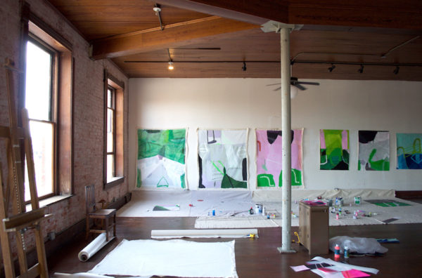 Sarah Boyts Yoder Studio: The studio pictured here occupies much of the second floor. The paintings are the work of resident Sarah Boyts Yoder. Photo credit: Kyle Hobratschk.