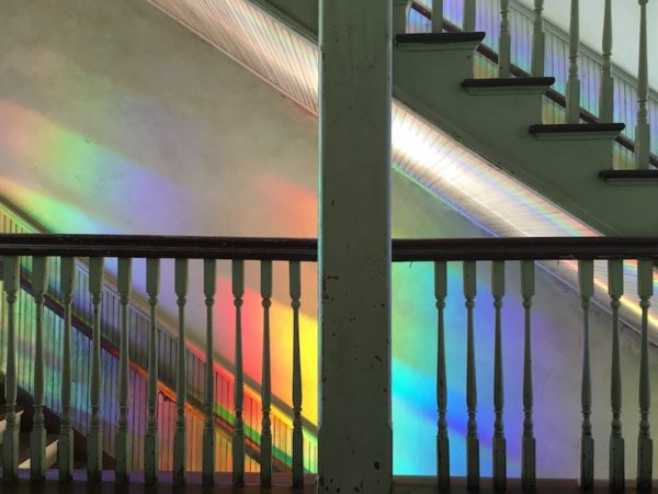 Window Rainbow: Much of the building has been restored to its original state, with gentle additions like this rainbow installation on the stairwell by Randell Morgan. Photo credit: Kyle Hobratschk.