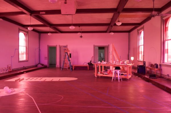 Pink room: During their stay, Alisha Croft and Marguerite Lloyd covered the many windows in their third floor studio with pink cellophane, casting the room in a strange pink glow. Photo Credit: Tatiana Ryckman.