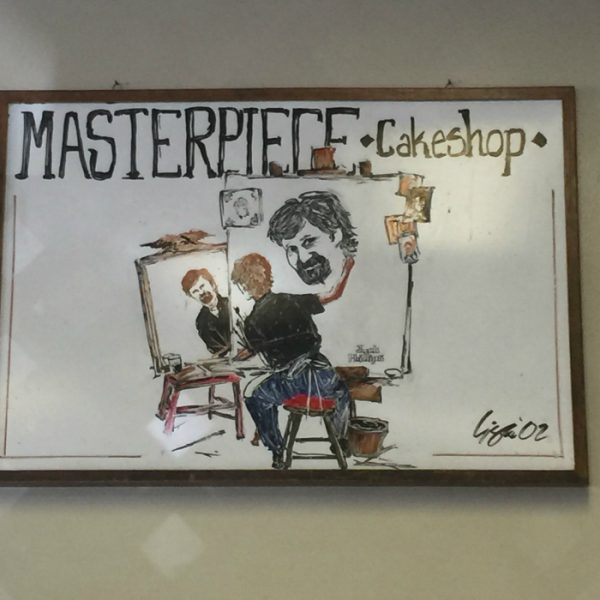 sign in Masterpiece Cake Shop