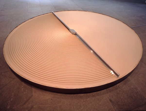 + and -, 1994-2004. Steel, aluminum, sand, and electric motor. 10 3/4 x 165 1/4 x 165 1/4 inches.