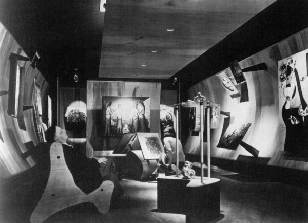 Frederick Keisler seated in the foreground of Peggy Guggenheim's gallery, Art of This Century, 1942 (Photo: Berenice Abbott)