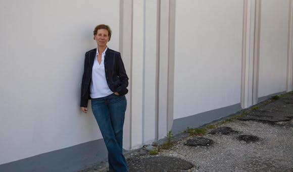 Francesca Fuchs in front of her current outdoor mural painting installation at Lawndale, Houston. Photo by Emily Peacock.
