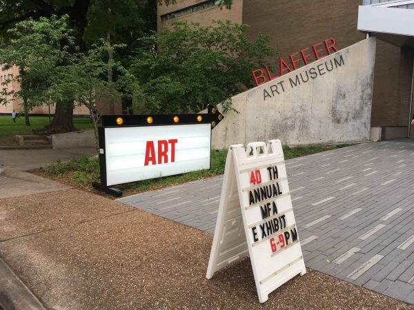The entrance to the UH MFA show featuring a sign by Alton DuLaney