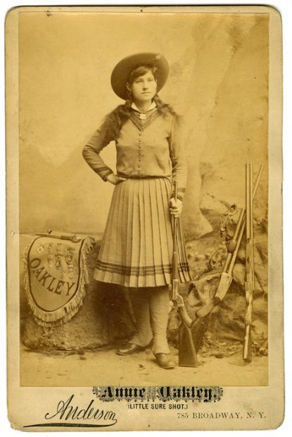 David H. Anderson (American, 1855-1905), Annie Oakley, Little Sure Shot, 1886. Albumen silver print, 16.4 x 10.7 cm. Albert Davis / Circus Collection, Harry Ransom Center.