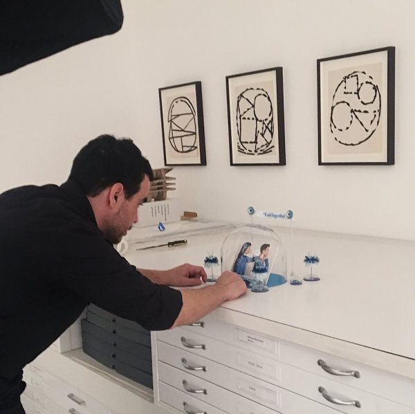Robleto with his artwork