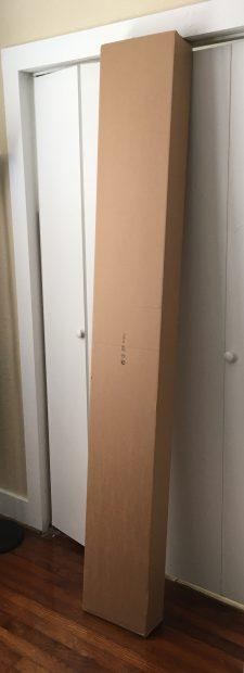 bookshelf leaning against wall