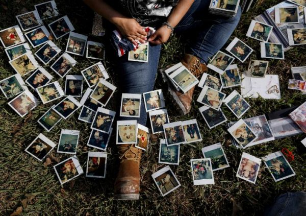Woman looking throuh photos after Hurricane Harvey
