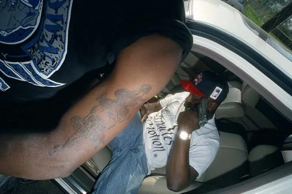 DeSoto photographed rapper Scarface of The Geto Boys holding a gun to his head.