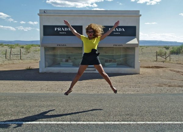 Beyonce in Marfa Texas in front of Prada Marfa