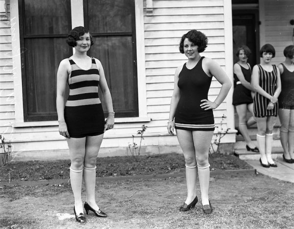 Girls model swimsuits to be worn at the bathing girl revue, a feature of the annual tourist day celebration, 1926. San Antonio Light Photograph Collection.