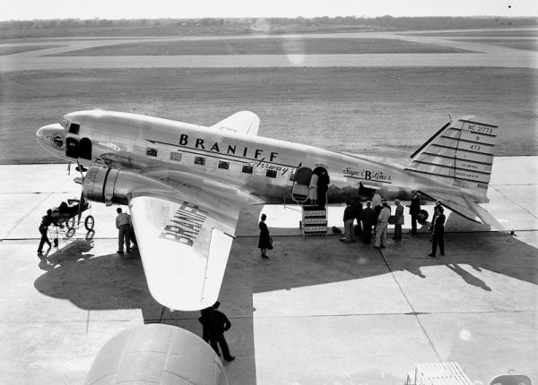 Passengers board airliner at Stinson Municipal Airport, 1939. San Antonio Light Photograph Collection