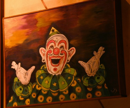 clown that looks like a saint in ecstasy glasstire
