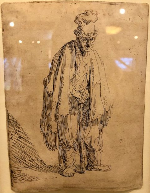 Rembrandt, Beggar in a high cap, standing and leaning on a stick, 1630.