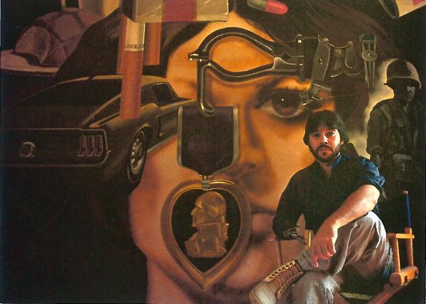 Treviño and his mural in 1984. Photo by Oscar Williams.