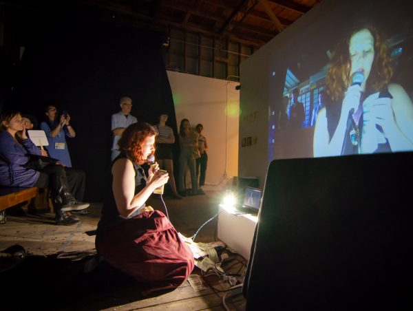 Julia Claire Wallace performing at the Satellite Art Show.