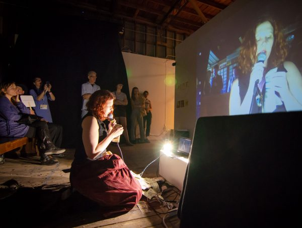 Julia Claire Wallance performing at the 2019 Satellite Art Show in Austin Texas