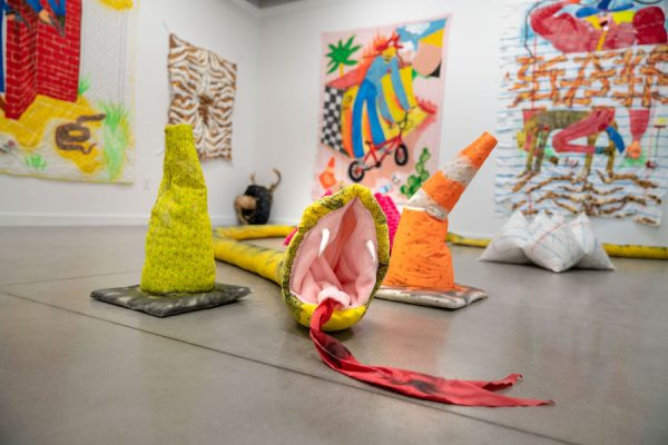 """Installation view of Alexis Mabry and Steef Crombach's """"M*A*S*H""""; Featured: Alexis Mabry and Steef Crombach, Better Coil Saul, muslin, found fabric, dye, chicken wire, poly-fil, sand, Great Stuff, leaves, bean bag balls, Plaster of Paris, 40' x 5"""""""