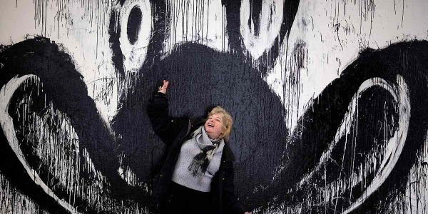 artist Joyce Pensato in front of one of her paintings