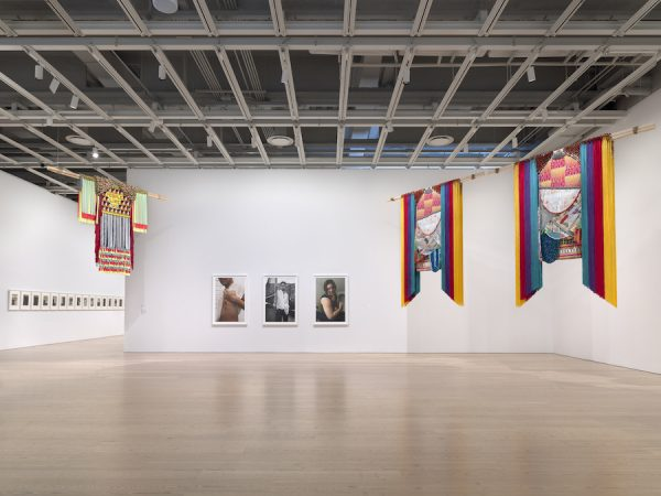 Installation view of the Whitney Biennial 2019. At left, Alexandra Bell's Friday series.