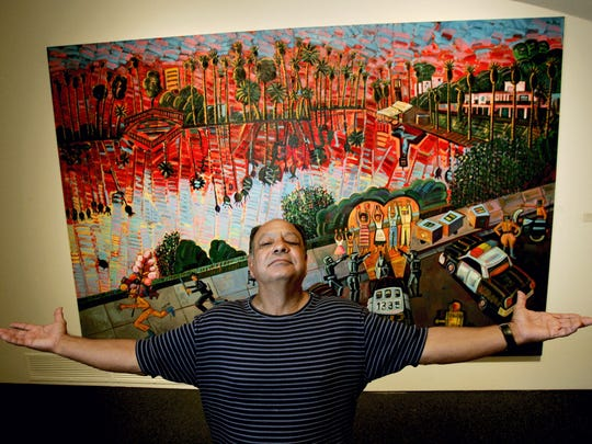 "Cheech Marin in front of Frank Romero's 1996 painting ""The Arrest Of The Paleteros (The Arrest Of The Popsicle Sellers). Photo: Reed Saxon, AP"