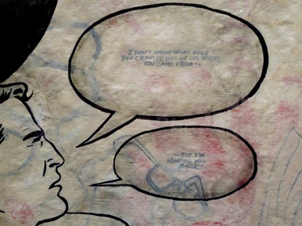 Enrique Chagoya, Crossing 1, detail of Superman's head and speech bubbles.