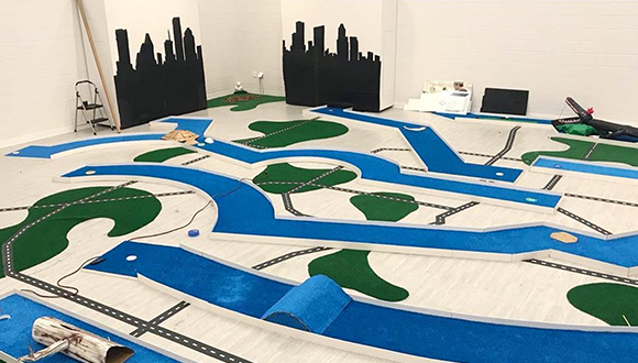 San-Jacinto-college-south-gallery-is-transformed-into-an-indoor-mini-golf-course-based-on-houston-bayou-system