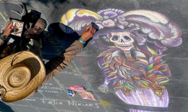 Felix Nieves, Catrina figure being rendered in chalk, 2009, Zocalo, Mexico City,
