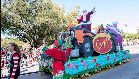 Chuy-Children-Giving-To-Children-Parade-Austin