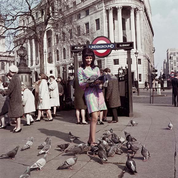 James Barnor, Drum Cover Girl Marie Hallowi at Charing Cross Station, London, 1966.