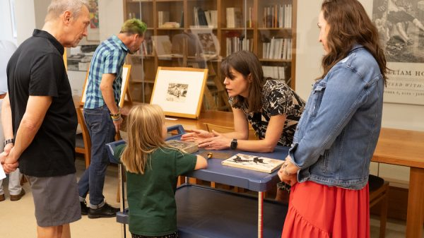 Curator of Prints and Drawings Holly Borham explains printmaking techniques to visitors