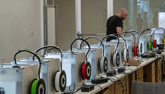 The Moody Center for the Arts has 15 additional 3D printers now running in its studio space, creating face shields under the supervision of Rob Purvis-(Photos by Jeff Fitlow)